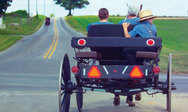 Amish people in an open buggy
