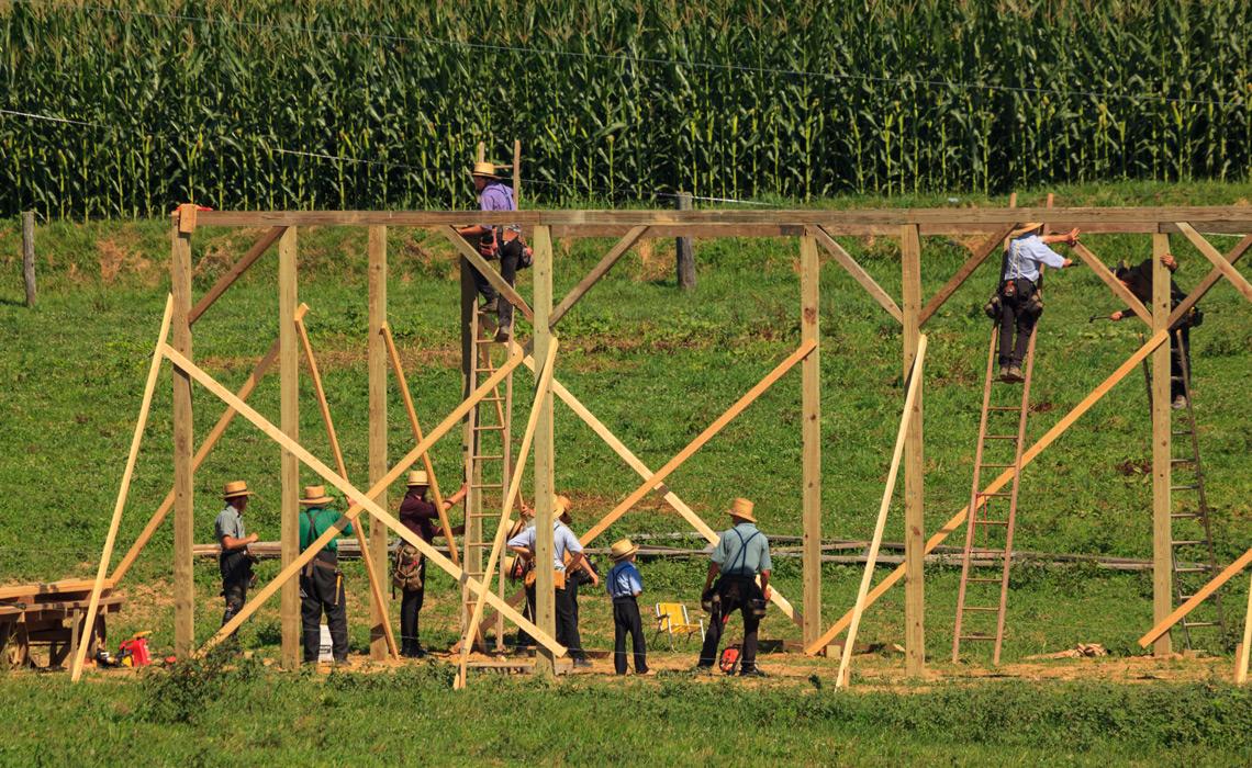 "New Providence, PA, USA - July 30, 2013: Amish farmers at a ""barn raising"" in rural Lancaster County."